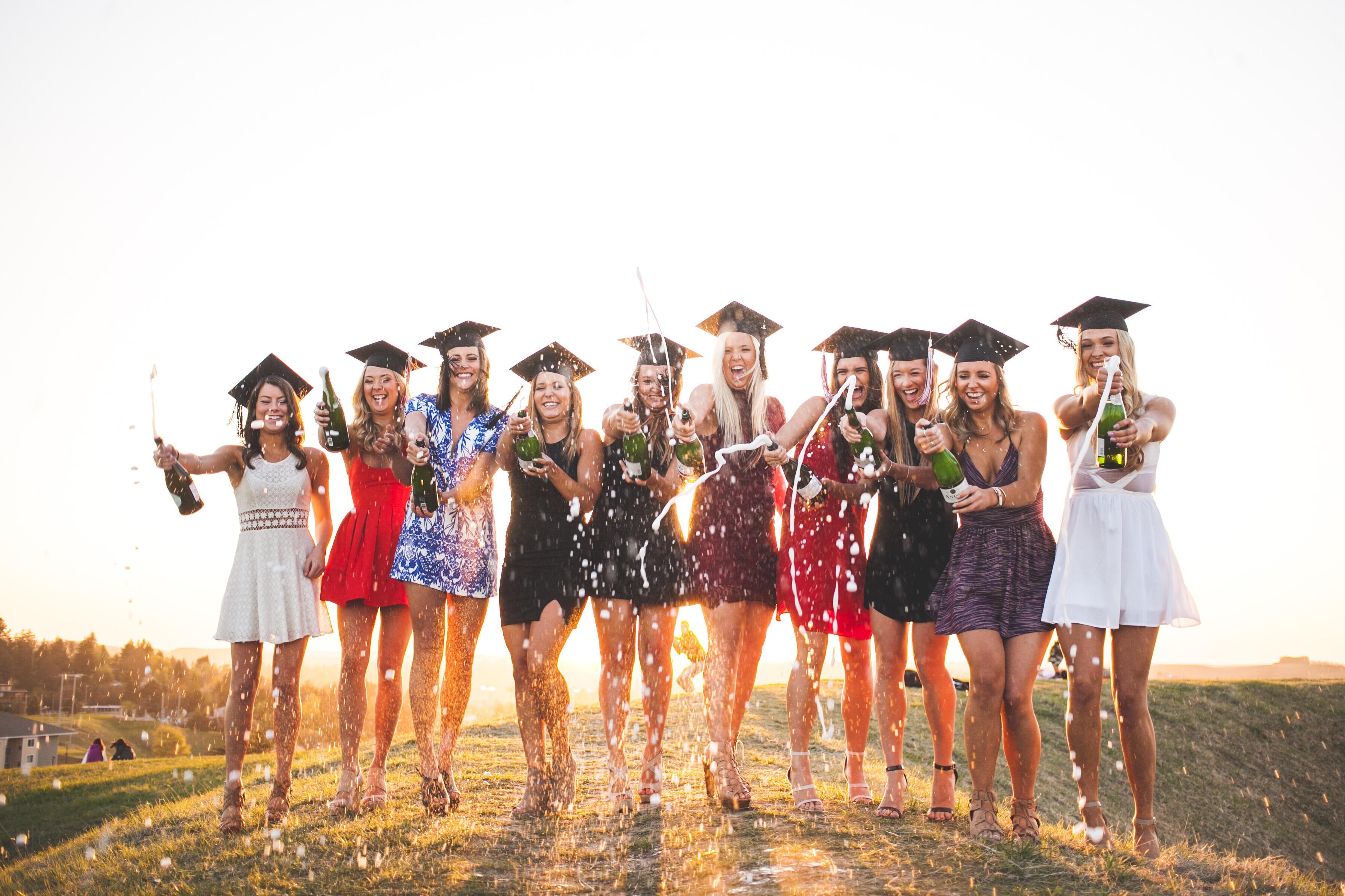 graduation girls popping champagne