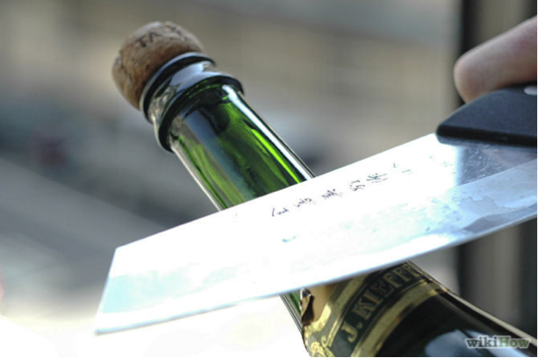 Open champagne with a knife
