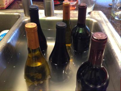 Soak wine bottle to remove label