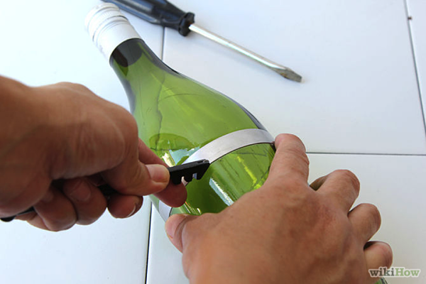 How to Make a Chandelier from Old Wine Bottles Step 2 Score Bottles