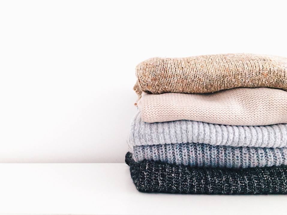 sweater stack of clothes