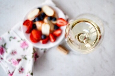 white wine with fruit bowl